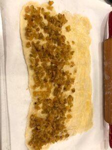 The vanilla scented golden raisins are spread onto half of the dough   urbnspice.com