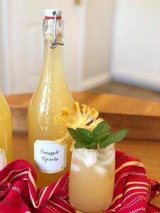 Refreshing Pineapple Tepache with mint and lime on ice