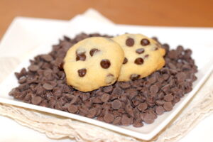 Picca-Bots - a chocolate chip cookie displayed on a small plate | urbnspice.com