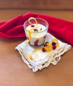 Dairy-Free White Chocolate Eggnog with Cranberry Coulis with orange garnish | urbnspice.com