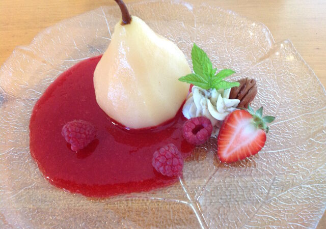 Poached Pear plated with raspberries