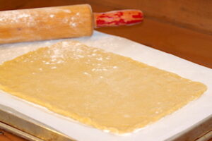 Rolling out biscotti dough into a triangle   urbnspice.com