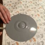 Tracing out a circular pattern for DIY reusable beeswax wrap.
