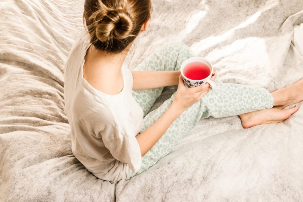 woman-wearing-pyjamas-sitting-on-bed