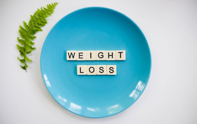 blue plate with the letters weight loss