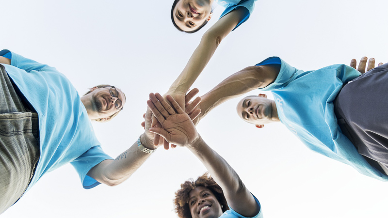 Group of people in a huddle