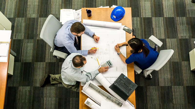 architects in a meeting looking at blueprints