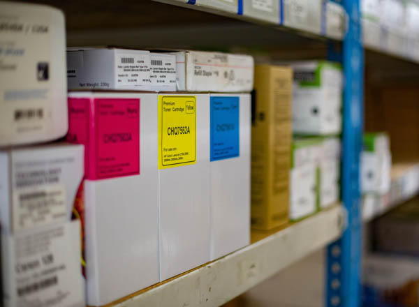 boxes of toner cartridges on shelf