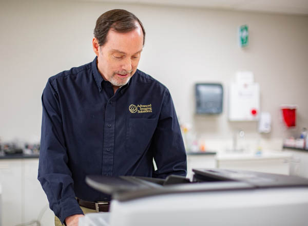 Service technician working on copier
