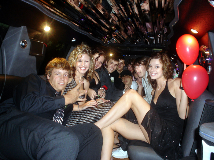Birthday Party Special limos and party buses for young adults. Men and women having fun in our limo birthday party package