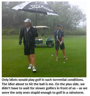 swingin in the rain - two golfers