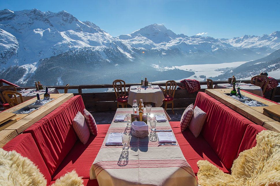 One of the great joys of skiing is outdoor dining at the summit restaurant, with stunning panoramas. Oh, make no mistake, you'll NEVER get this table. You'll be lucky to find a stool in the kitchen. These restaurants are always packed.