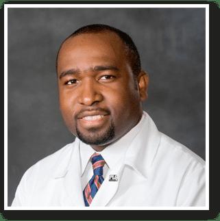 Dr-Ayoola-Headshot-Whit-Coat