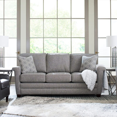 Bexley Sofa with Contrasting Pillows and Nailhead