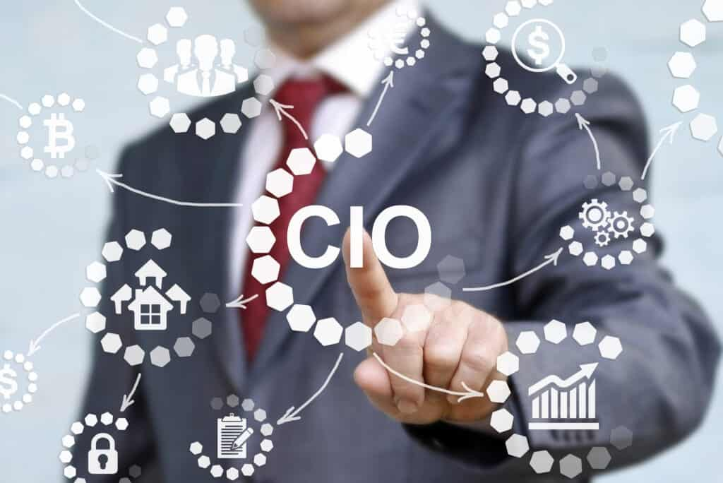 Man in a suite using his finger to point at a floating graphic of CIO