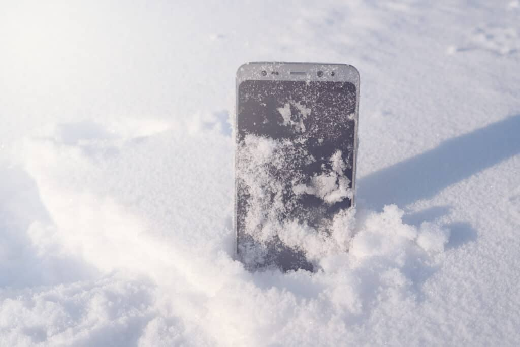 phone place upright in snow