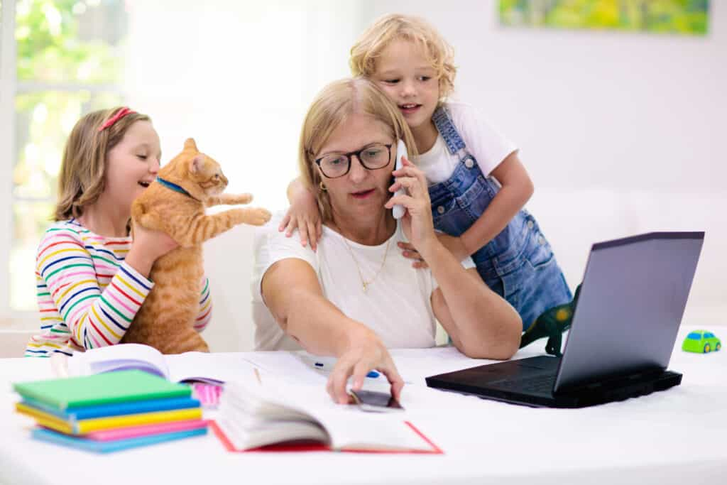 mom working from home with distracting kids and pets