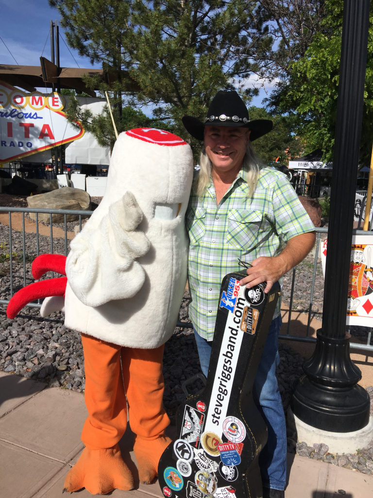 Steve Griggs posing with mascot in Fruita California.