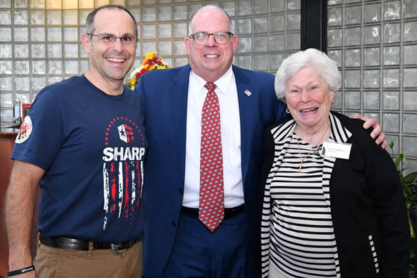 Hub Labels President Thomas Dahbura and original founder Mary Dahbura welcome Governor Larry Hogan to Hub Labels. Photo Courtesy of the Governors Office.