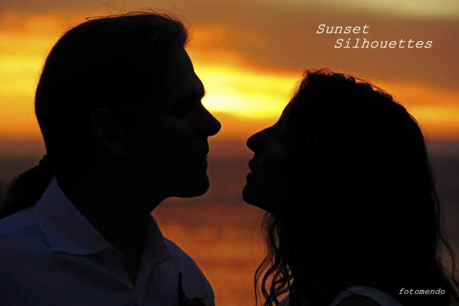 Sunset Silhouettes -- backlit by a red sky, Paula and Chris gaze deeply into each other's eyes.
