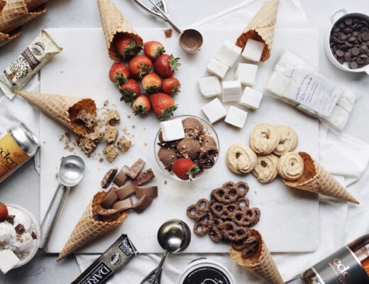 Ice cream board with various ice cream toppings.