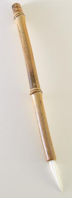 "Medium size 2"" bristle length Stiff White Synthetic, with bamboo cane handle."