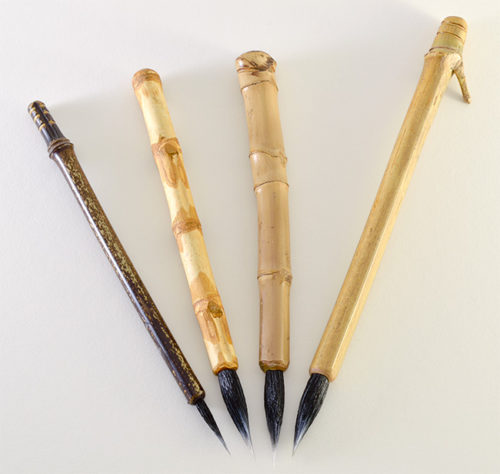 "Small, Medium, Wangi Medium, and Large Size Goat Synthetic blend brushes with 1.5"" inch bristle length."