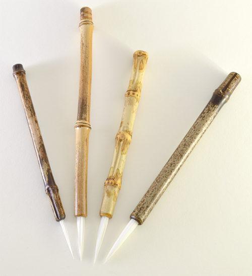 """Brush set with small, medium, wangi medium, and large size 2"""" bristle length Stiff White Synthetic, with bamboo cane handle."""
