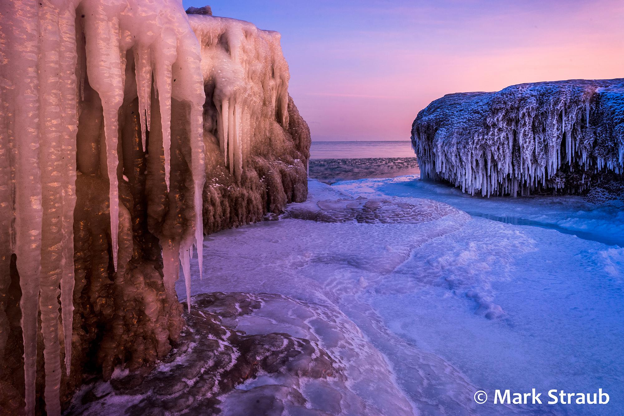 The frozen shore of Lake Michigan at sunrise