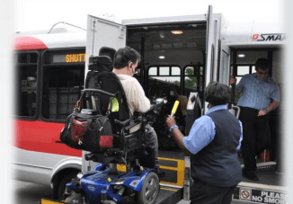 Person in wheelchair being raised into Southuburban Mobility Authority for Regional Transportation bus