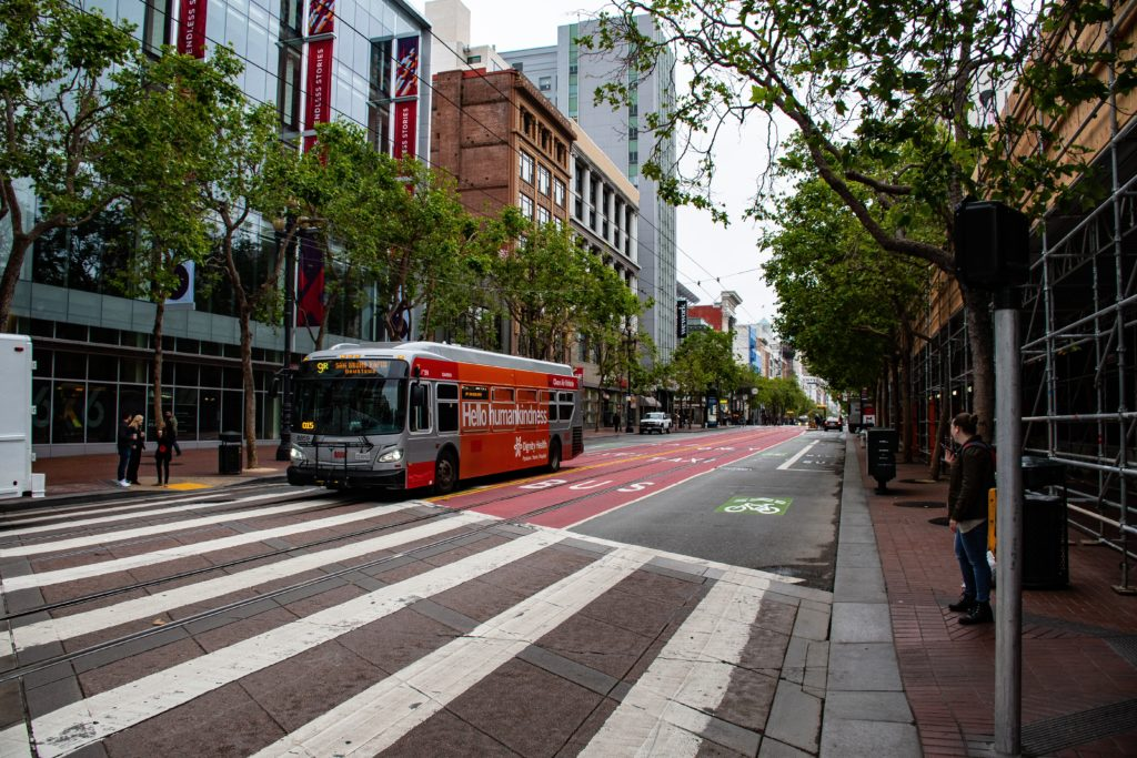 Photo of San Francisco street with bike lane and bus