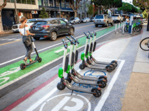 Photo of scooters parked in a designated scooter coral (box painted on the street)