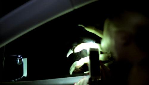raking hand outside car