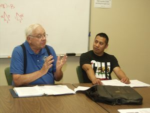 RSVP volunteer Tom Stenklyft (left) facilitates a financial literacy class that includes student Gustavo Solares, at First United Methodist Church in Appleton.