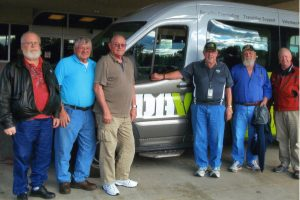 Veterans James Stone (from left), Clem Balthazor, Jim Stern and Dennis Runyan (second from right) await transportation by volunteer driver Gerry Arens (right) at the Appleton clinic. Cal Gardner (third from right) also is a longtime volunteer driver for veterans.