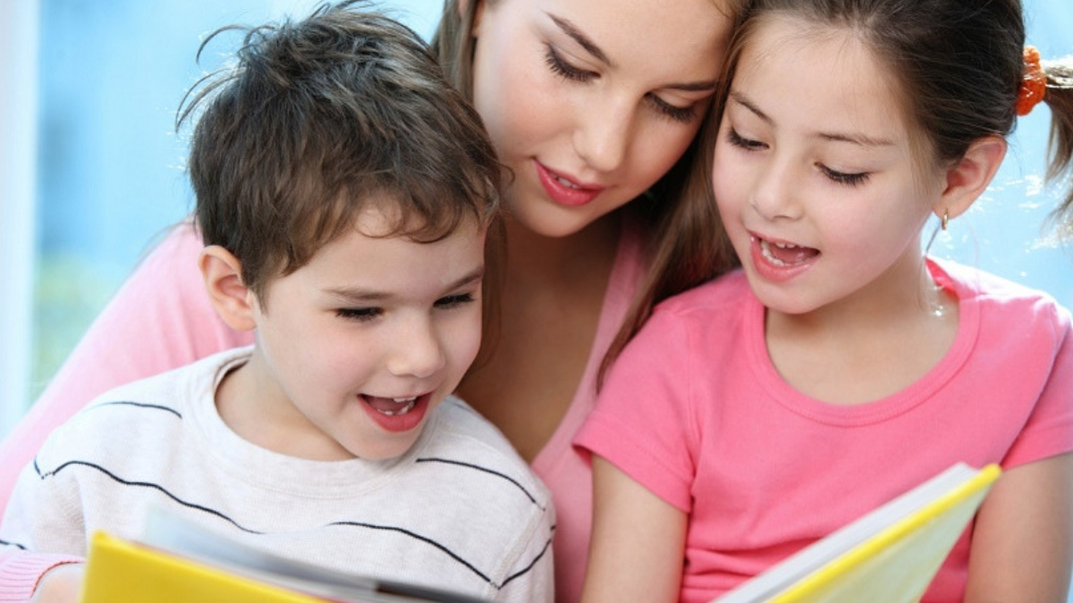 nanny and kids reading a book