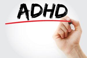 Image of hand writing ADHD on Medical Marijuana & ADHD page