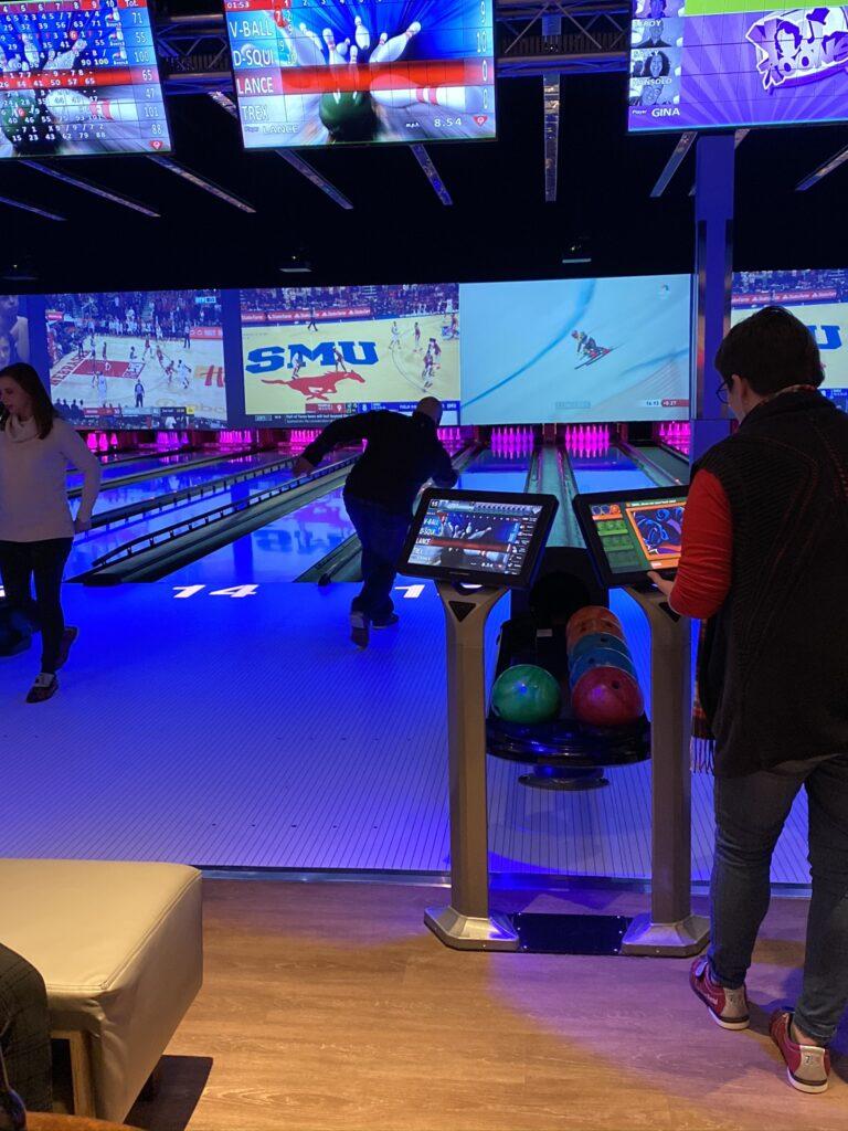 Person bowling at Team BQMI Holiday Gathering
