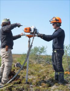 Sam Hunter and Adam Kirkwood extract a permafrost cores from a palsa in Polar Bear Park