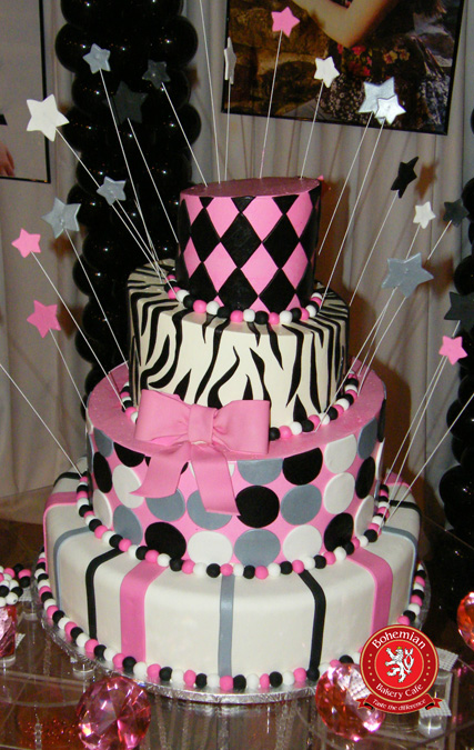sweet 16 four tiered round whimsical cake pink black silver sugar bow polka dots zebra harlequin