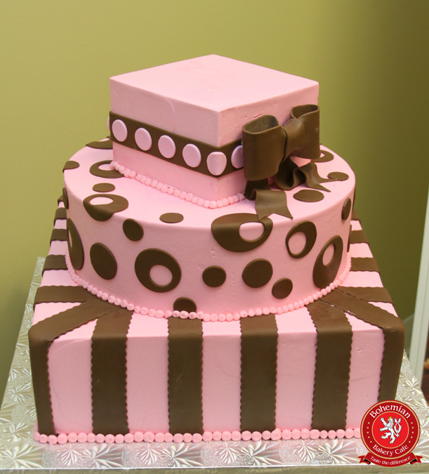 Sweet 16 three tiered cake pink and brown with bow