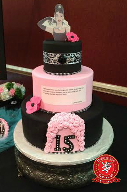 Sweet 16 three tiered cake black and pink with pink sugar flowers
