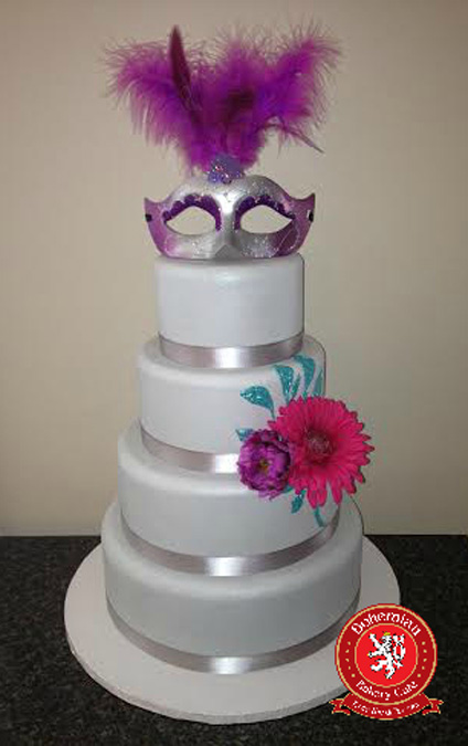 sweet 16 four tiered round cake silver purple and pink masquerade silver mask