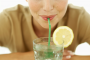 Woman Drinking Lemon Water for Sugar Detox