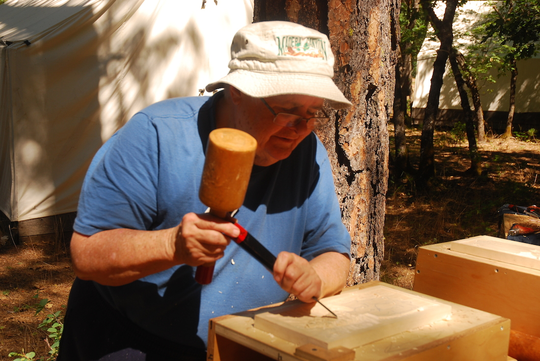 Woodcarving Student with Hammer
