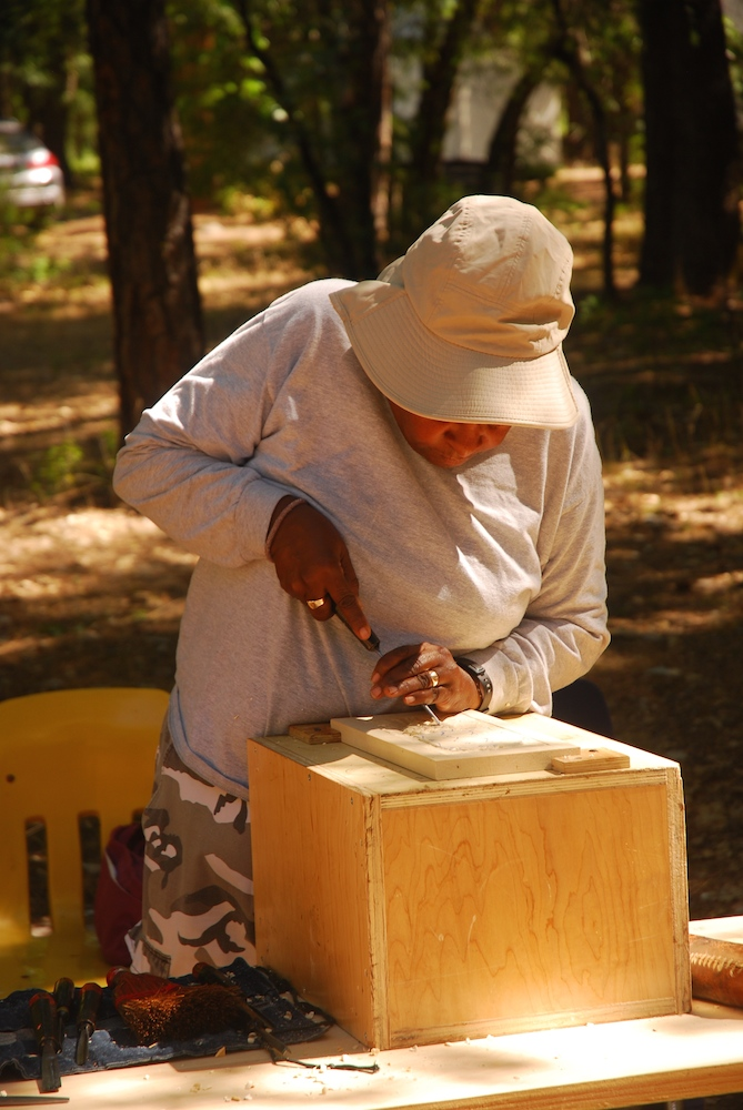 Woodcarving Student with Chisel