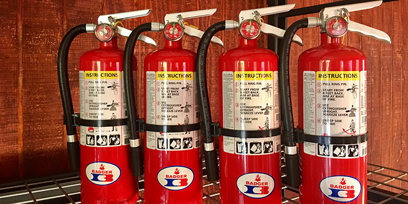 Group of Fire Extinguishers Ready to Be Installed