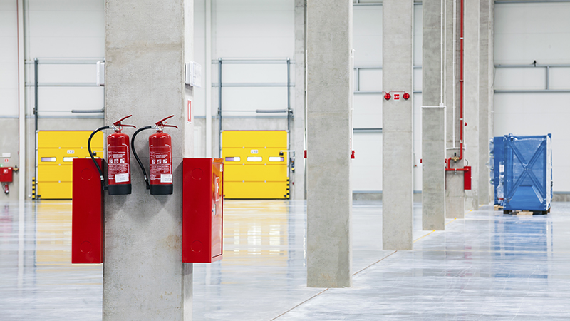 Fire Extinguishers Mounted in Warehouse