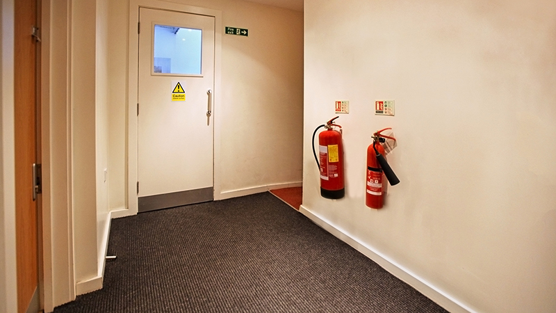 Fire Extinguishers Mounted on Wall
