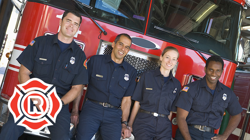 Firemen in Front of Fire Engine with Truss Sign